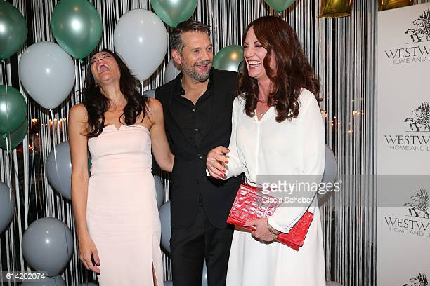 Bettina Zimmermann and her partner Kai Wiesinger and Natalia Woerner during the 5th anniversary of Westwing on October 12 2016 in Munich Germany