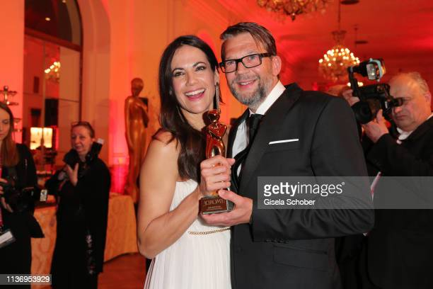 Bettina Zimmermann and her partner Kai Wiesinger pose with their award during the ROMY award at Hofburg Vienna on April 13 2019 in Vienna Austria