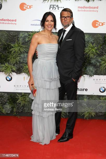 Bettina Zimmermann and Kai Wiesinger attend the Lola - German Film Award red carpet at Palais am Funkturm on May 03, 2019 in Berlin, Germany.