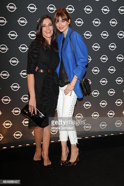 MUNICH GERMANY JANUARY Bettina Zimmermann Eva Padberg attend the presentation and vernissage of the calender 'THE ADAM BY BRYAN ADAMS' for Opel at...