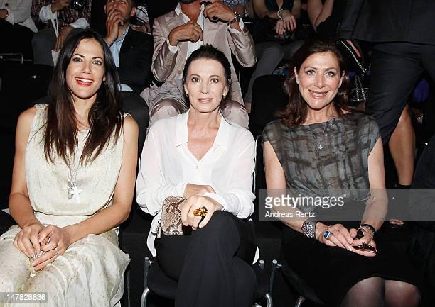 Bettina Zimmermann Iris Berben and Alexandra von Rehlingen sit in front row during the Dawid Tomaszewski Show at the MercedesBenz Fashion Week...
