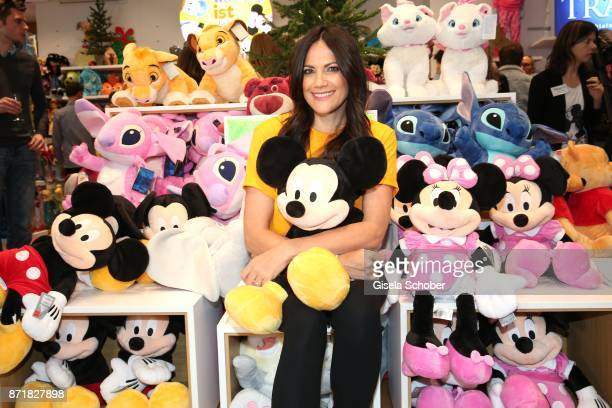 Bettina Zimmermann with plush toy Mickey Mouse and Minnie Mouseduring the Disney Store VIP opening on November 8 2017 in Munich Germany