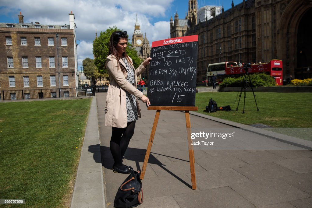 A betting company employee holds up betting odds on a blackboard in College Green outside the Houses of Parliament on April 18, 2017 in London, England. British Prime Minister Theresa May has called a general election for the United Kingdom, to be held on June 8. The last election was held in 2015 with a Conservative party majority win.