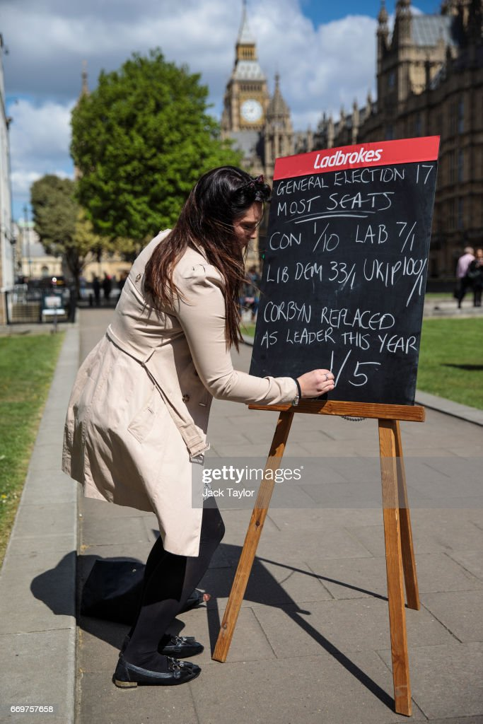 A betting company employee writes betting odds on a blackboard in College Green outside the Houses of Parliament on April 18, 2017 in London, England. British Prime Minister Theresa May has called a general election for the United Kingdom, to be held on June 8. The last election was held in 2015 with a Conservative party majority win.