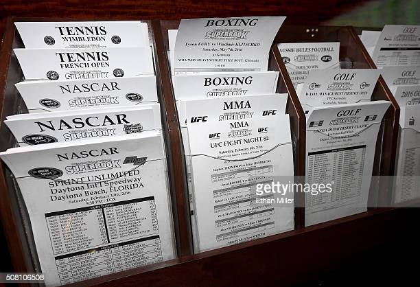Betting sheets for NASCAR golf boxing and MMA are stacked at the Race Sports SuperBook at the Westgate Las Vegas Resort Casino on February 2 2016 in...