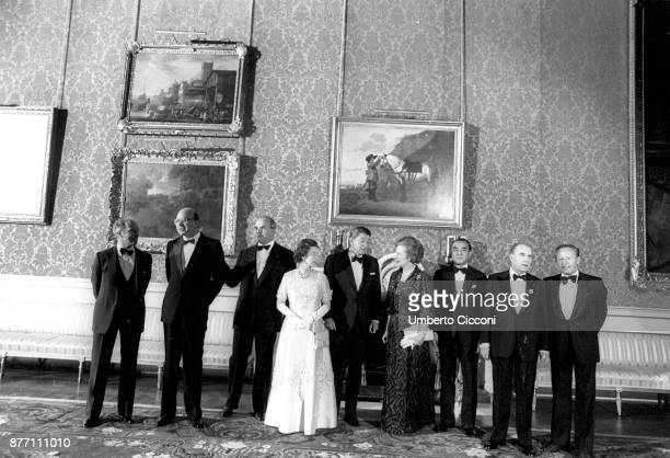 Bettino Craxi Helmut Kohl Queen Elizabeth II Ronald Reagan Margaret Thatcher Yasuhiro Nakasone and François Mitterrand at Buckingham Palace in 1985