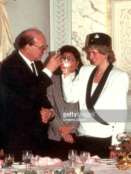 Bettino Craxi makes a toast with Princess Diana during a welcome party for the royalty in Villa Doria Pamphili Rome 1985