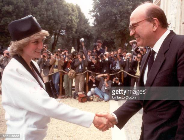 Bettino Craxi shakes the hand of Princess Diana during a welcome party for the royalty in Villa Doria Pamphili Rome 1985