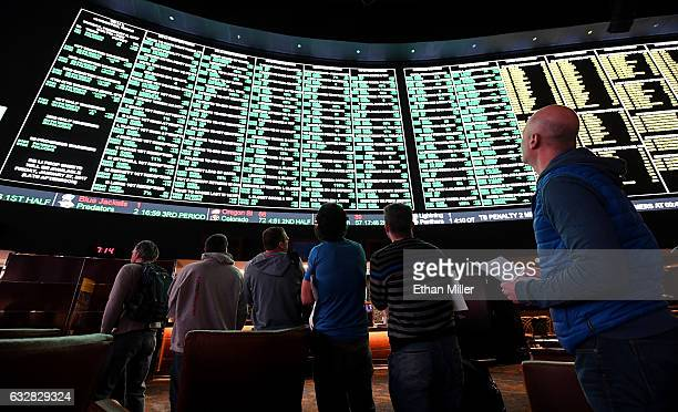 Bettors line up to place wagers after more than 400 proposition bets for Super Bowl LI between the Atlanta Falcons and the New England Patriots were...