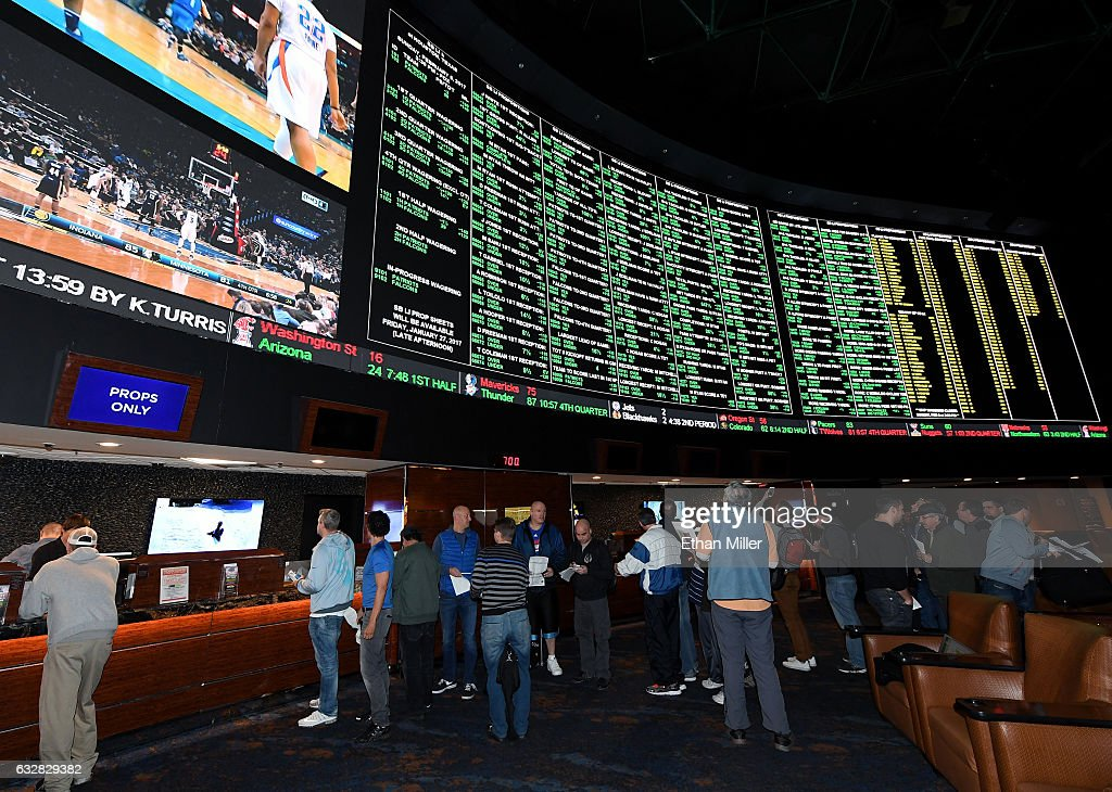 Bettors line up to place wagers after more than 400 proposition bets for Super Bowl LI between the Atlanta Falcons and the New England Patriots were posted at the Race & Sports SuperBook at the Westgate Las Vegas Resort & Casino on January 26, 2017 in Las Vegas, Nevada.