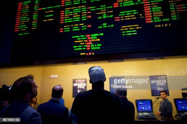Bettors place wagers at Dover Downs Casino on June 5, 2018 in Dover, Delaware. Delaware is the first state to launch legal sports betting since the...