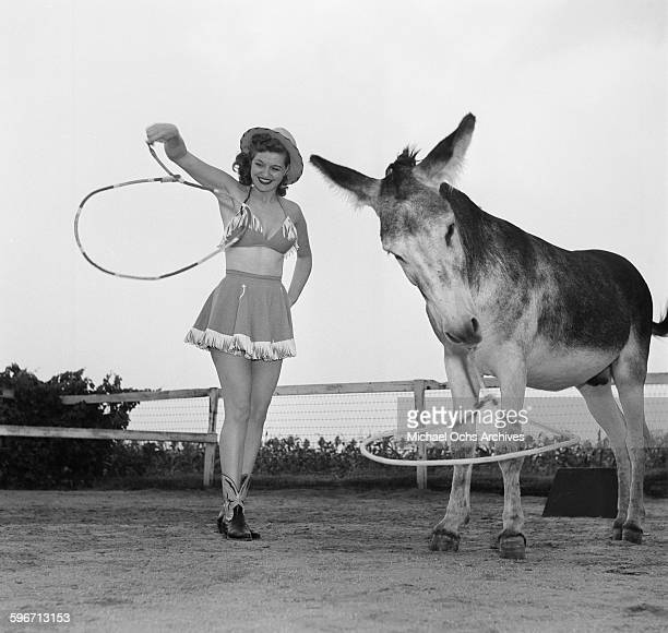 Betty Ames and her donkey Jackson perform a rope trick in Los AngelesCalifornia