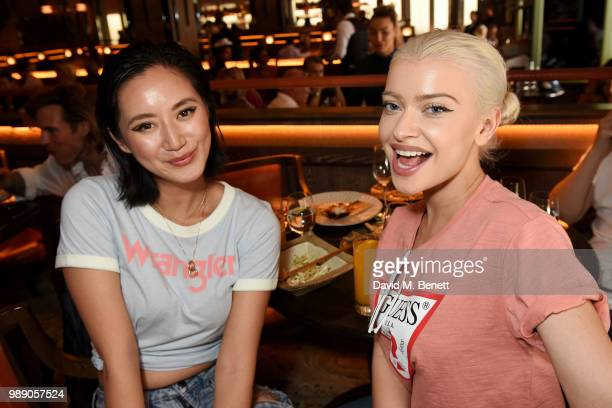 Betty Bachz and Alice Chater attend The Grimmy Brunch Series at Sexy Fish on July 1 2018 in London England
