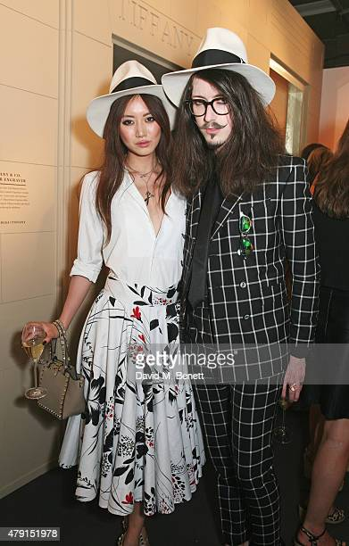 Betty Bachz and Joshua Kane attend the Tiffany Co immersive exhibition 'Fifth 57th' at The Old Selfridges Hotel on July 1 2015 in London England