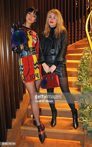 Betty Bachz and Kara Marshall attend MCM's London Flagship Opening Party on December 6 2016 in London England