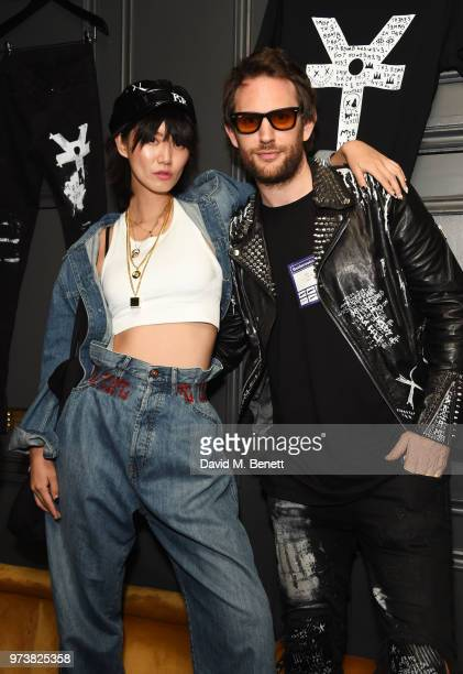Betty Bachz and Marc Jacques Burton attend the MJB x YOTA fashion capsule party supported by Ciroc who have designed MJB x YOTA Limited Edition...