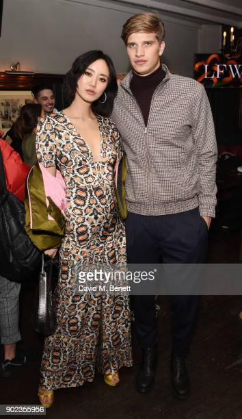 Betty Bachz and Toby HuntingtonWhiteley attend the LFWM Official Party Pub LockIn during London Fashion Week Men's January 2018 at The George on...