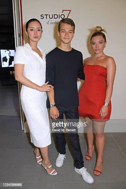 """Betty Bachz, Conrad Khan and Florence Pugh attend a private view of """"Studio 7 By Cartier"""" at The Saatchi Gallery on July 21, 2021 in London, England."""