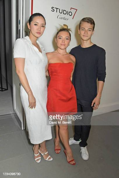 """Betty Bachz, Florence Pugh and Conrad Khan attend a private view of """"Studio 7 By Cartier"""" at The Saatchi Gallery on July 21, 2021 in London, England."""