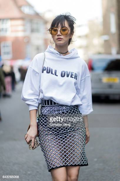 Betty Bachz wearing a white hoody with the print pull over a transparent pencil skirt outside Sharon Wauchob on day 4 of the London Fashion Week...