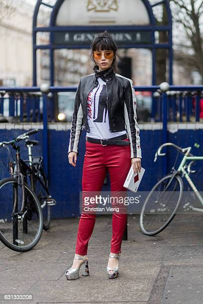 Betty Bachz wearing red leather pants black biker leather jacket retro sunglasses during London Fashion Week Men's January 2017 collections at...