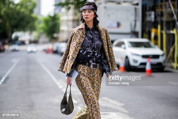 Betty Bachz wearing suit with leopard print is seen during London Fashion Week Men's June 2018 on June 9 2018 in London England