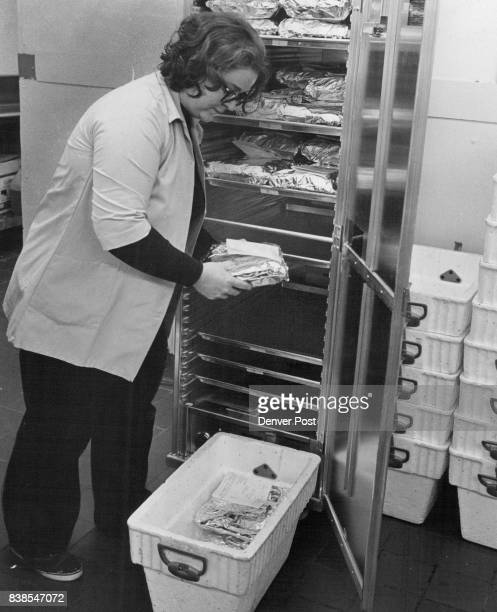 Betty Bell HCS supervisor removes wrapped labeled meals from warming oven and packs them 12deep into insulated hamper for home delivery Credit Denver...