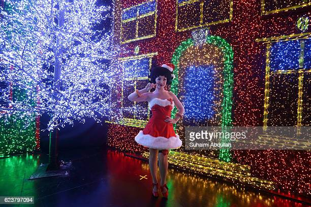 Betty Boop impersonator poses for a photo during the media preview of Universal Journey a Santa's AllStar Christmas at Universal Studios Singapore on...