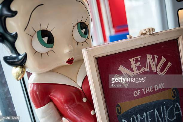 Betty Boop statue with menu outside fifties 1950s style café
