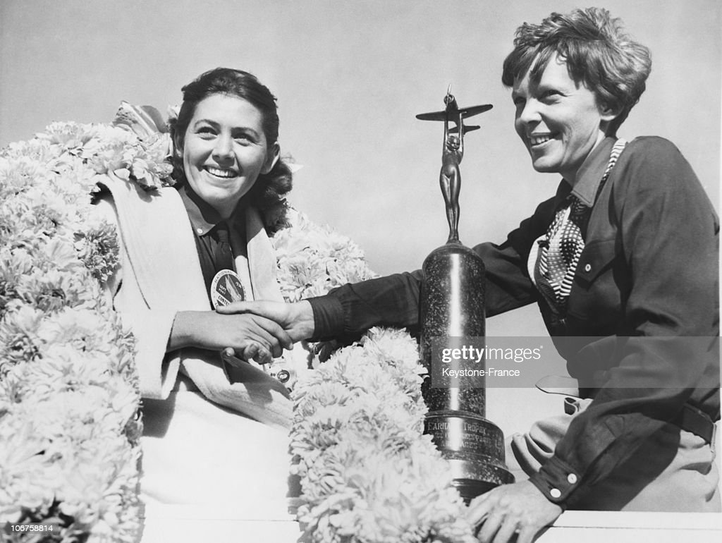 Betty Browning, winner of the Amelia Earhart Trophy Race, receives the trophy from aviatrix Amelia Earhart, Los Angeles, May 1936.