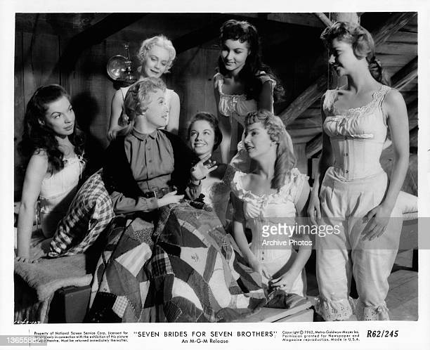 Betty Carr Nancy Kilgas Virginia Gibson Julie Newmeyer Ruta Kilmonis and Norma Doggett in their under garments listening to Jane Powell in a scene...