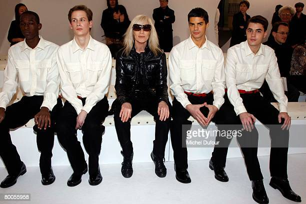 Betty Catroux and boys attend the Yvest Saint Laurent show during Paris Fashion Week FallWinter 20082009 at the Grand Palais on February 28 2008 in...