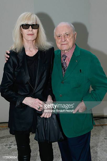 Betty Catroux and Pierre Berge attend Yves Saint Laurent Menswear Spring/Summer 2014 show as part of Paris Fashion Week on June 30 2013 in Paris...