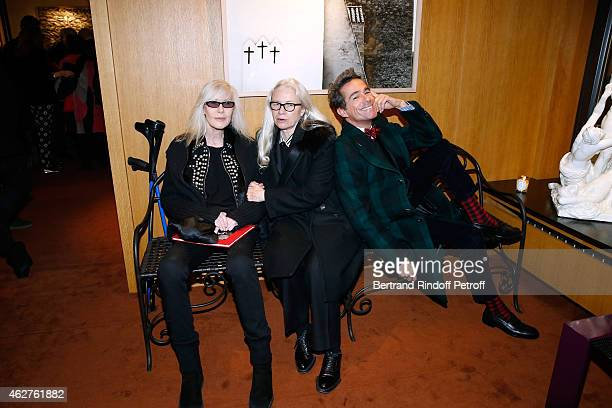 Betty Catroux Photographer Dominique Issermann and Vincent Darre attend the Patrice Calmettes Exhibition at Galerie Passebon on February 4 2015 in...
