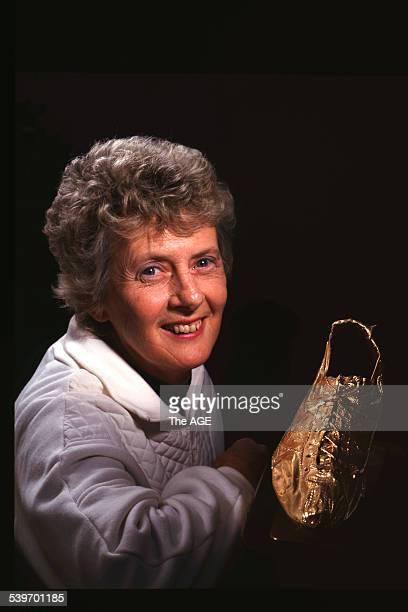 Betty Cuthbert photographed with her golden shoe 8 October 1994 THE AGE GOOD Picture by BRENDAN READ