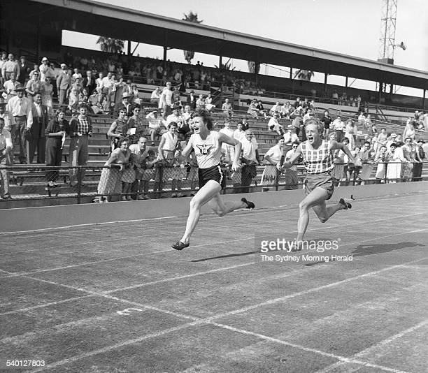 Betty Cuthbert right and Marlene Matthews race to the finish line during the Women's Athletics State Championship and RH North Cup at the...