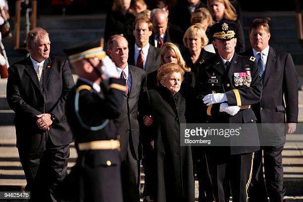 Betty Ford stands holding the arm of her son Steve Ford second from left along with Major General Guy Swan III second right and Jack Ford right...