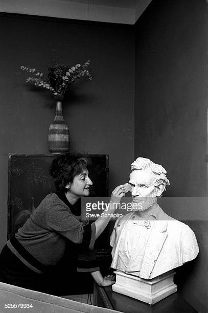 Betty Friedan attends to Abraham Lincoln bust in her home