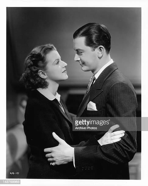 Betty Furness and Robert Young embracing each other in a scene from the film 'The Three Wise Guys', 1936.