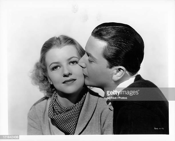 Betty Furness getting a kiss on the cheek from Robert Young in a scene from the film 'The Band Played On', 1934.