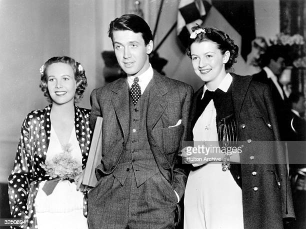 Betty Furness, right, visiting Wendy Barrie and James Stewart durning the filming of an MGM picture.