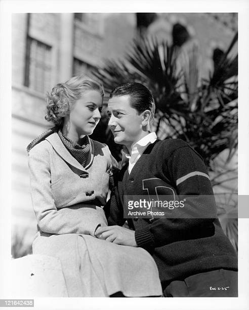Betty Furness sitting close with Robert Young in a scene from the film 'The Band Played On', 1934.