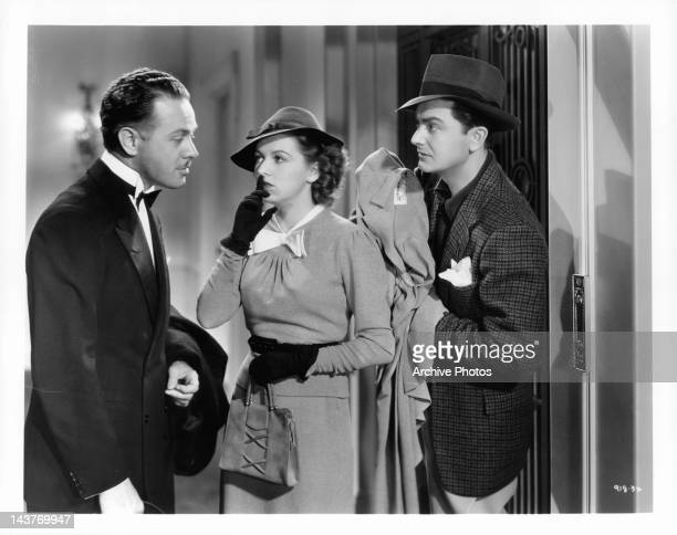 Betty Furness telling man to remain silent as Robert Young stands by in a scene from the film 'The Three Wise Guys', 1936.