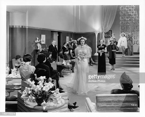 Betty Furness wearing wedding dress in a scene from the film 'The Three Wise Guys', 1936.