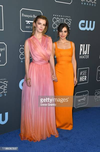 Betty Gilpin and Alison Brie attend the 25th Annual Critics' Choice Awards at Barker Hangar on January 12, 2020 in Santa Monica, California.