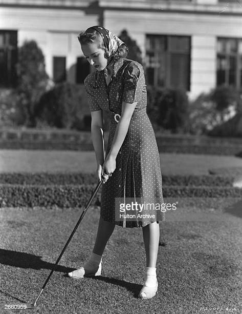 Betty Grable American leading lady and pinup practises her golf Original Publication People Disc HF0282