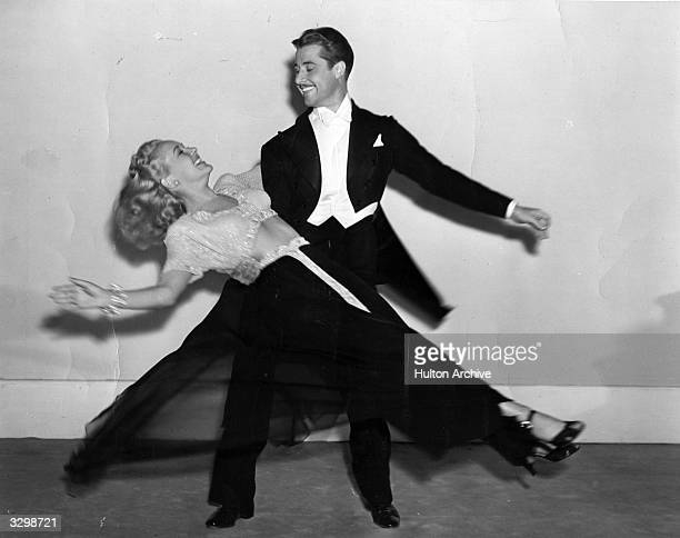 Betty Grable and Don Ameche during a fast dance routine from the musical film 'Down Argentine Way', directed by Irving Cummings for 20th Century Fox.