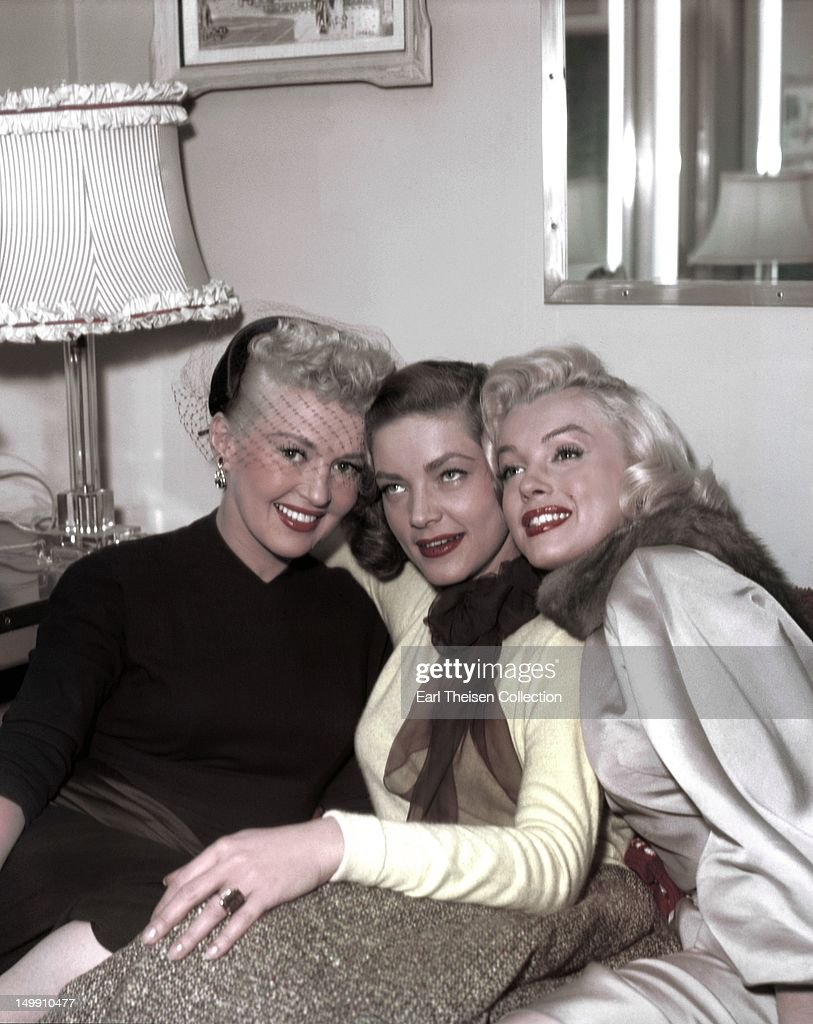 Betty Grable, Lauren Bacall and Marilyn Monroe pose for a portrait on the set of the 20th Century-Fox film 'How to Marry a Millionaire' in 1953 in Los Angeles, California.