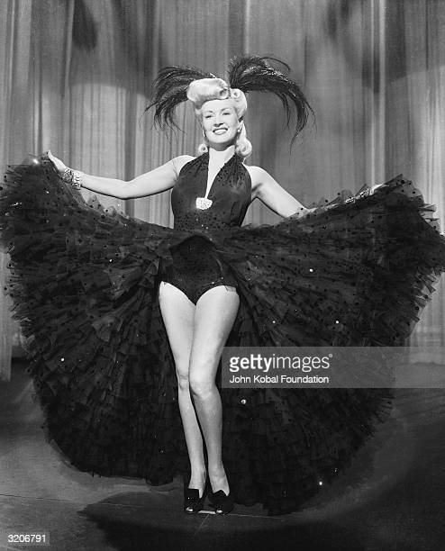 Betty Grable shows off her famous legs as dancer Lorry Jones in 'PinUp Girl' directed by H Bruce Humberstone