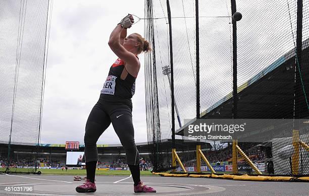 Betty Heidler of Germany ccompetes in the Women's Hammer Throw during second day of the European Athletics Team Championship at Eintracht Stadion on...